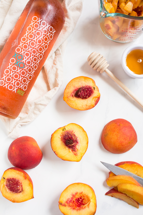 This creamy vegan peach rosé sorbet is perfectly sweet with a slight kick and doesn't require an ice cream maker via @ExSloth | ExSloth.com