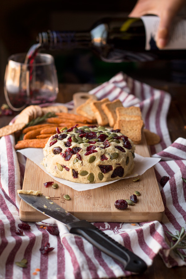 Vegan Lentil Cashew Cheese Ball - An easy vegan cheese recipe topped with cranberries and pumpkin seeds. Perfect for holiday or Christmas parties   ExSloth.com