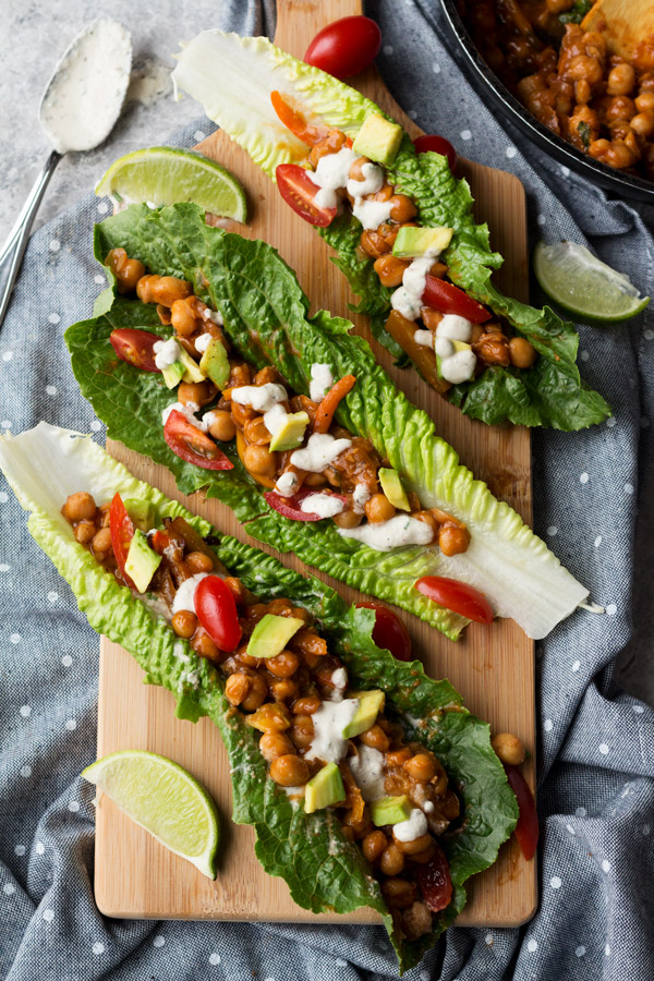These BBQ chickpea lettuce wraps with vegan ranch dressing are bursting with sweet and smokey bbq flavour and make great light and easy vegan lunches | ExSloth.com