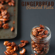 These gingerbread glazed roasted nuts use the traditional sweet and spicy flavour of gingerbread men to give a treat perfect for holiday parties or gifts via @ExSloth | ExSloth.com #Christmas