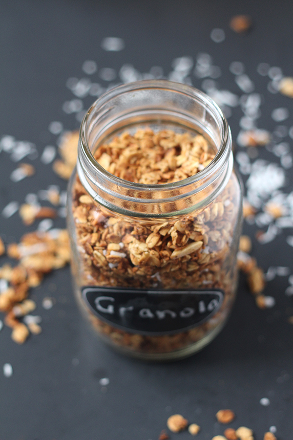 This coconut almond granola is easy to make, ready in under 30 minutes and full of delicious flavour. Plus, it's vegan, gluten free and refined sugar free via @ExSloth | ExSloth.com