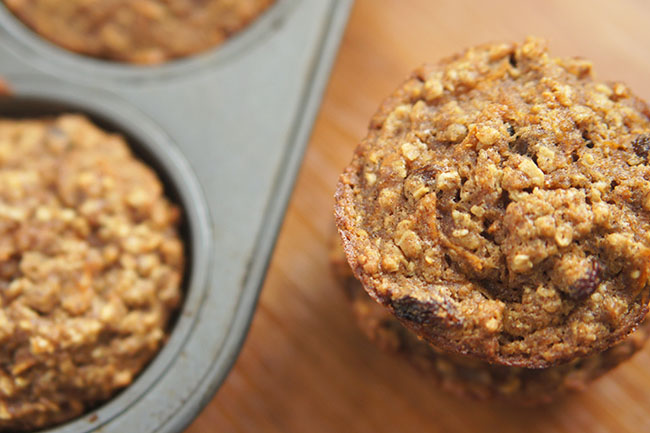 These dairy free carrot raisin oatmeal muffins contain no added sugars and are dense, chewy and wholesome. The raisins also add extra sweetness to each bite @ExSloth | ExSloth.com