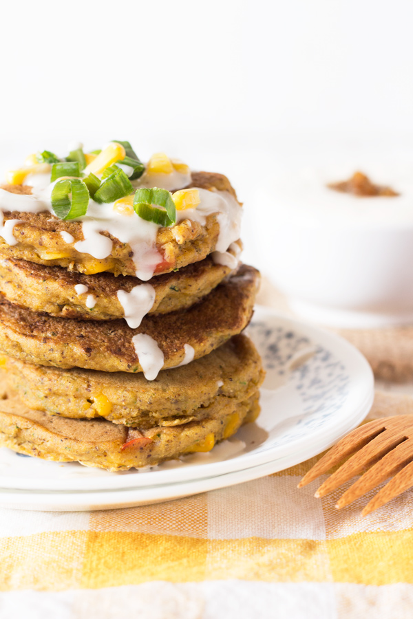 Zucchini Corn Savoury Pancakes (cornmeal pancakes) with spicy vegan sour cream. Perfect for breakfast, lunch and dinner. via @ExSLoth | ExSloth.com