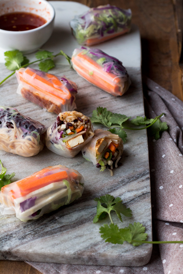These baked rice paper rolls are hearty, flavourful , slightly crispy and perfectly sweet and spicy. A great gluten-free and vegan alternative to traditional spring rolls. via ExSloth.com