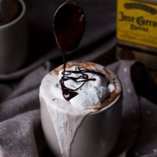 This tequila spiked Mexican hot chocolate is thick, creamy and perfectly spiced with a little kick from the tequila. It's also vegan, gluten-free and paleo (if you use 100% agave tequila) via ExSloth.com
