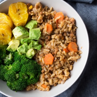 This Trini-style lentils and rice bowl is filled with tonnes of Caribbean inspired plant-based flavours and makes the perfect healthy vegan buddha bowl for lunch or dinner | ExSloth.com