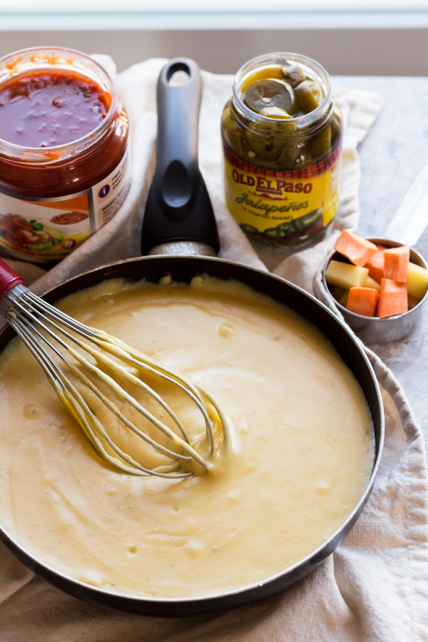 This nut-free vegan queso dip is made with potatoes instead of cashews but is just as creamy and flavourful | ExSloth.com